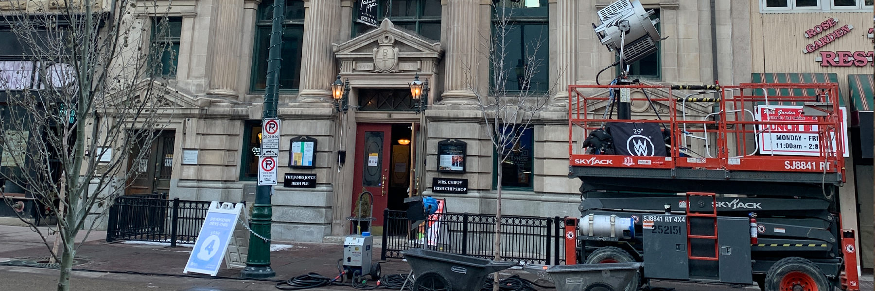 Filming equipment in front of historic calgary building